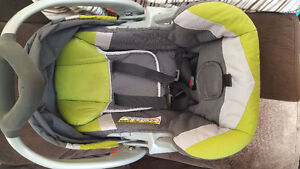 Baby Trend brand car seat with 2 bases