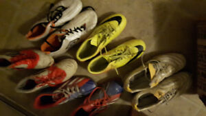 various Nike and Adidas soccer cleats and indoor shoes