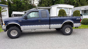 2002 Ford F-350 blue with grey sidepanels Pickup Truck