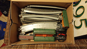 3 boxes of HO trains.
