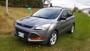 2014 Ford Escape SE.  27,700kms
