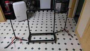 Various Guitar Stands, One 5 Guitar Stand and Two Single