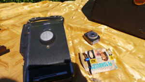 Antique polaroid camera and some other brands and movieprojector