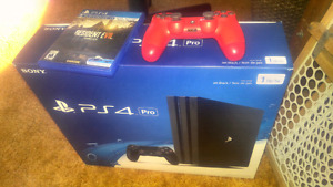 Ps4 playstation pro with extra controller and resident evil
