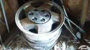 Two aluminum chev 1500   truck rims. Are 16 inch with centers