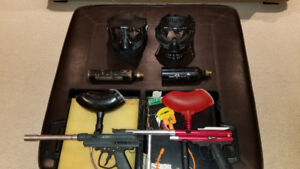 Two paint ball guns and accessories