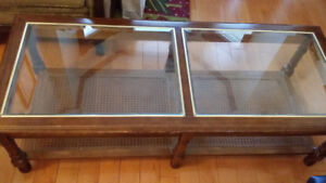 Used coffee table with glass top and lower shelf