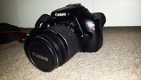 Canon Rebel T3 Digital SLR Camera with Bag, SD Card and UV Lens
