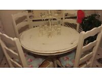 Solid White dining table with 4 chairs