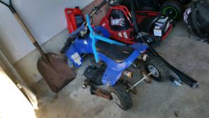 Two 49 cc mini quads