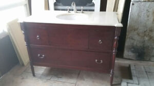 Beautiful cherry wood vanity with beige granite top