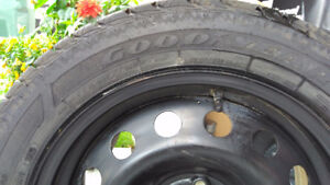 4 Goodyear winter tires with rims for sale