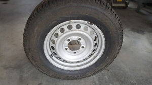Gently used winter tires and rims for a tundra