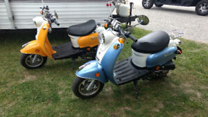 2 New  Scooters