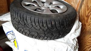 Four winter tires on rim