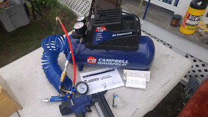 Air compressor with 2 inch nailer and accesories