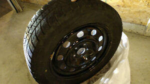 Set of Blizzak WS80 235 55 R 17 winter Tires with steel rims.