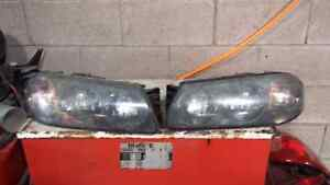 LEFT AND RIGHT HEADLIGHTS FOR A 2000 IMPALA Windsor Region Ontario image 1