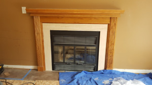 Wood burning fireplace insert with air vent and fan