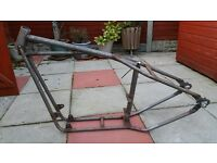 Rigid frame with log book to fit 1984-2003 Harley Davidson Sportster.