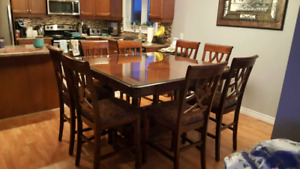Pub style table w 8 chairs, and glass top
