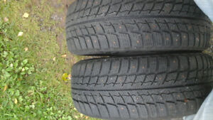 2 studded Winter Tires. 205 55 r16