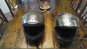2 motorcycle helmets and jackets