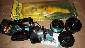 old mitchell fishing reel & large musky lure
