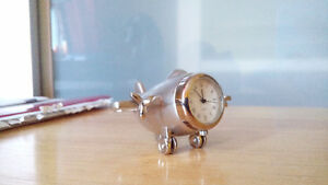 Little quartz watch in miniature plane