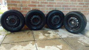 4 Hankook Winter ipike tires on rims. 185/60R14 82T. 4 bolts