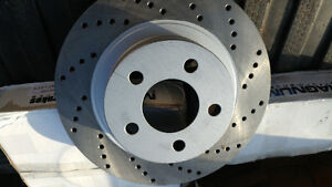 brakes - pair of front rotors - new
