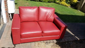 3 seater and a 2 seater red leather look sofas