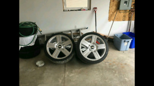 """Chev 24"""" Rims and tires. With senors."""