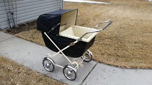 Antique baby carriage - restored