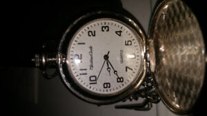 MANS QUARTZ POCKET WATCH WITH WOLFS ON FRONT COVER 15.00