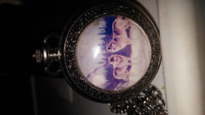 MANS QUARTZ POCKET WATCH WITH WOLFS ON FRONT COVER 15.00 FIRM