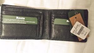 Brand new Roots men's wallet