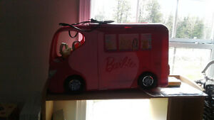 Barbies with accessories and big camper
