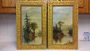A pair of antique landscape oil paintings