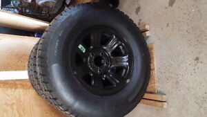 Four Tempra winter snow tires with steel rims 235 74R 15.