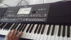 Korg keyboard  Pa600 with korg paddle , new case,stand and cover