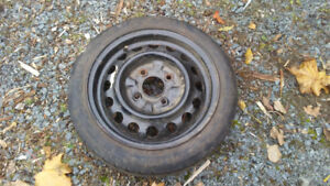 Dummy tire, Donut tire, Spare tire from a 2004 Nissan Sentra
