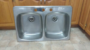 Double stainless steel sink I have two 3 hold or 4