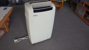 climatiseur,humidificateur portatif Haier 12,000 BTU excellent