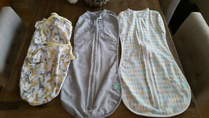 Three brand new swaddle / peanut sleep sacks