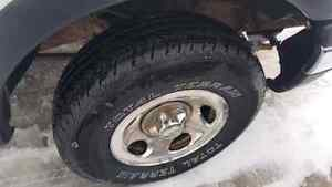 Like New  Total Terrains + Ford Rims