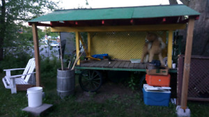 Antique farm wagon. Now a covered market stand.