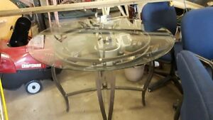 Six upholstered swivel chairs and glass topped table