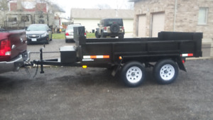New 3 1/2 ton dump trailer, with remote dump and tarp