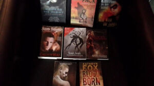 8 soft-cover fantasy/supernatural/thriller books.